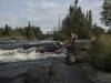 hauling-a-canoe-over-a-rock-step