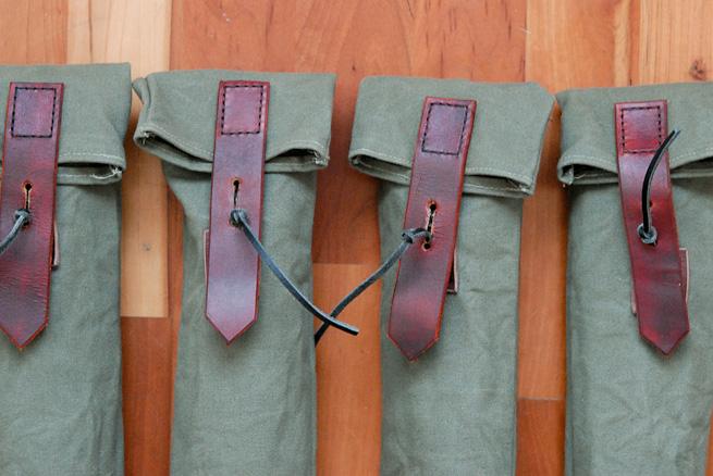 Folding bucksaw slip cases