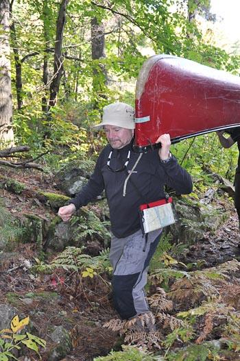 Hamish portaging a canoe